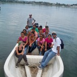 Student group arriving at ARCAS by boat on Lake Peten, Guatemala